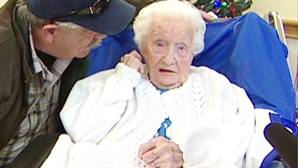 Merle Barwis sits with family on her 111th birthday in December, 2011.