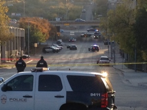Police tape marks off the scene after authorities shot and killed a man who they say opened fire on the Mexican Consulate, police headquarters and other downtown buildings early Friday, Nov. 28, 2014, in Austin, Texas. In the distance, police cars surround the suspect's vehicle parked near the Interstate 35 overpass. (AP/Jim Vertuno)