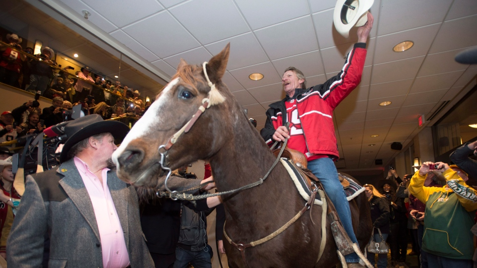Calgary Grey Cup Fans Horse Around With Mare In Vancouver