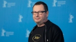 """Director Lars von Trier poses for photographers at a photo call for the film """"Nymphomaniac"""" at the International Film Festival Berlinale in Berlin, Feb. 9, 2014. (AP / Axel Schmidt, File)"""