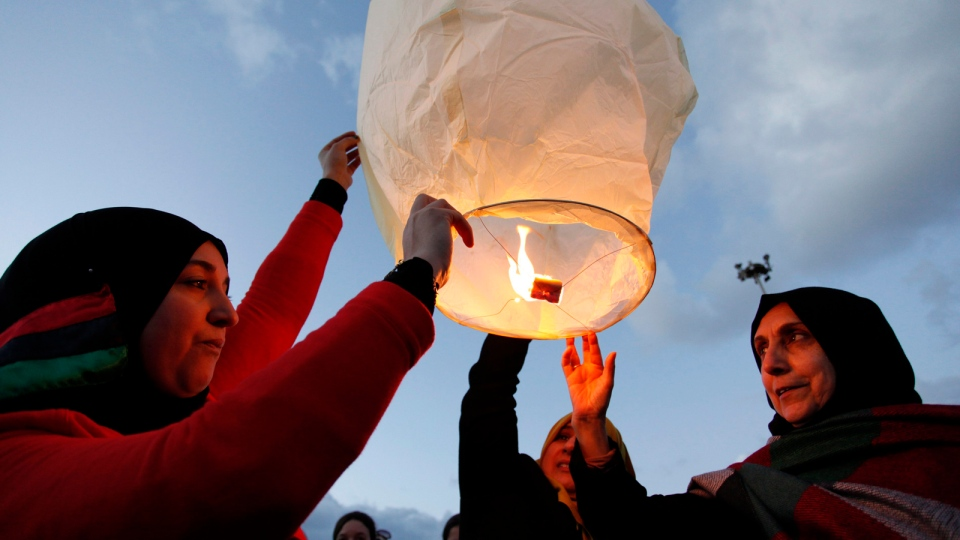 Libyans release a lantern in the air at Nasr Square, during the second anniversary of the uprising that toppled longtime dictator Moammar Gadhafi in Benghazi,Sunday, Feb. 17, 2013. (AP / Mohammad Hannon, File)