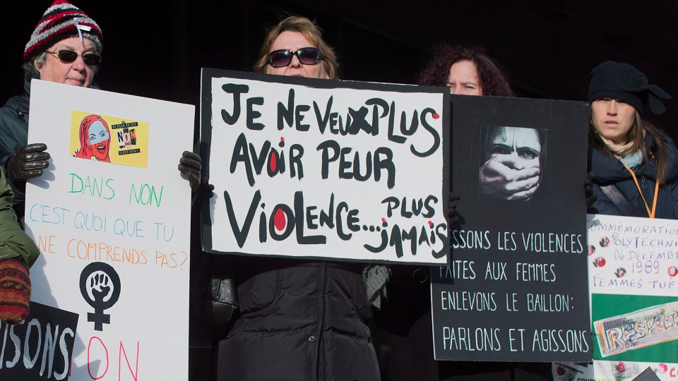 Four women attend a demonstration in Montreal on Dec. 6, 2013, to highlight violence against women. (THE CANADIAN PRESS / Graham Hughes)