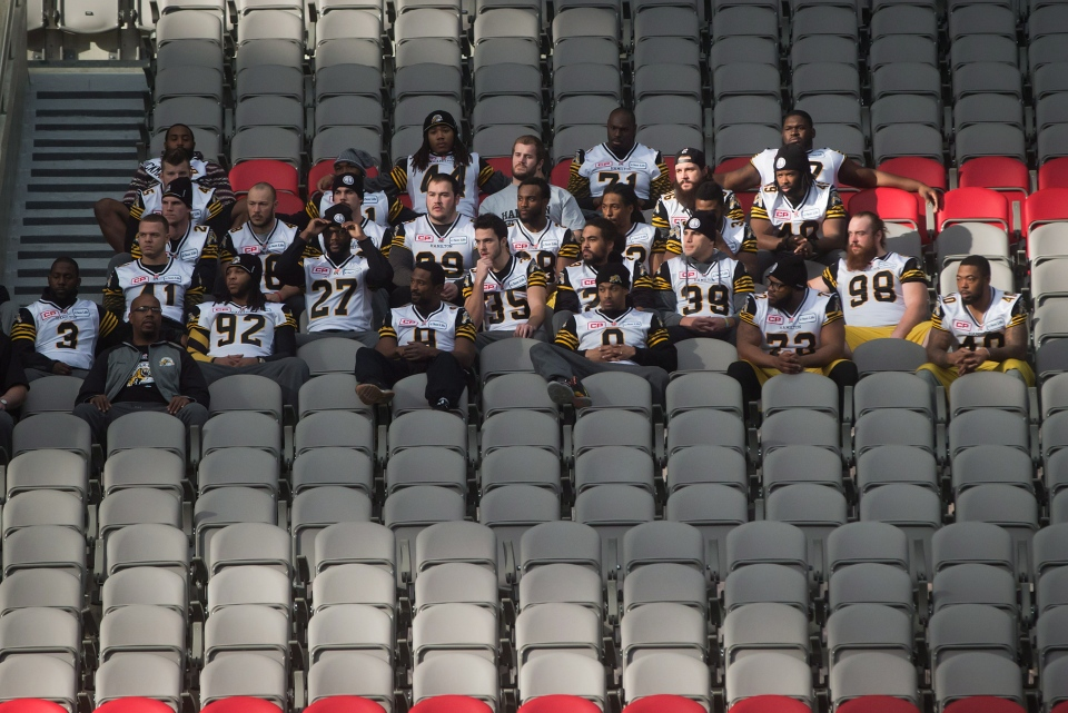 Hamilton Tiger-Cats defensive players sit in the stands for a meeting after a Grey Cup walkthrough in Vancouver, B.C., on Saturday November 29, 2014. (THE CANADIAN PRESS/Darryl Dyck)