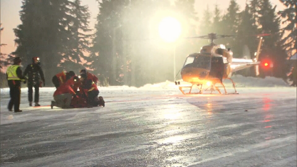 An injured hiker was airlifted by rescue crews after he fell from Tim Jones Peak atop Mount Seymour Sat., Nov. 29, 2014. (CTV)