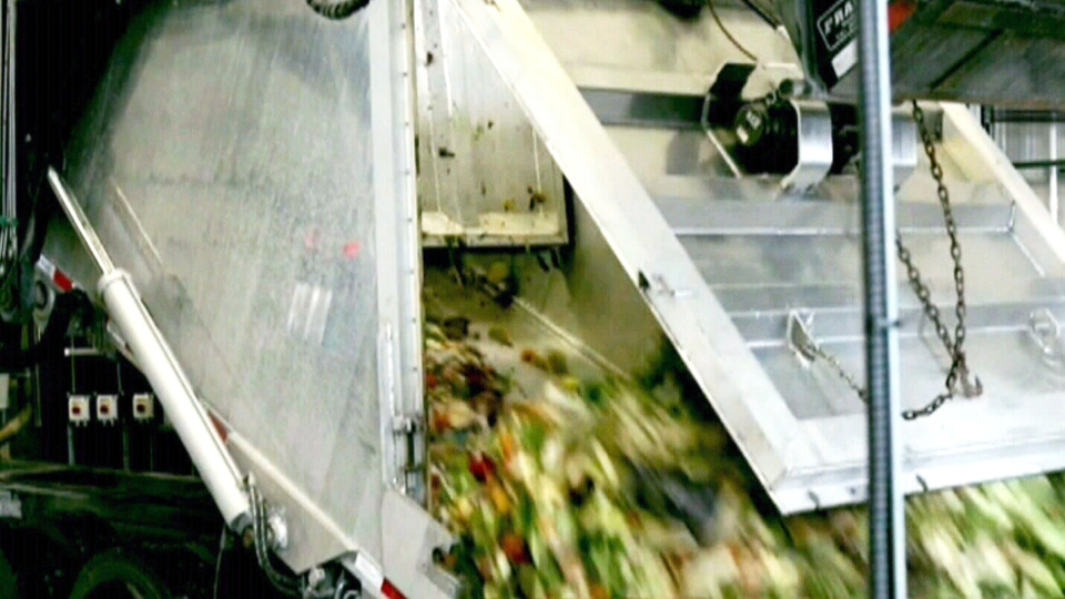A truck drops of organic waste at a processing plant in Ste-Hyacinthe, Que.