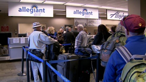 Allegiant Air passengers wait in line at the airport in Bellingham, Washington. April 4, 2012. (CTV)