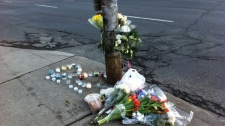 Flowers and notes make up a memorial at the scene of a fatal crash on Mount Pleasant Road in Toronto on Wednesday, April 4, 2012.