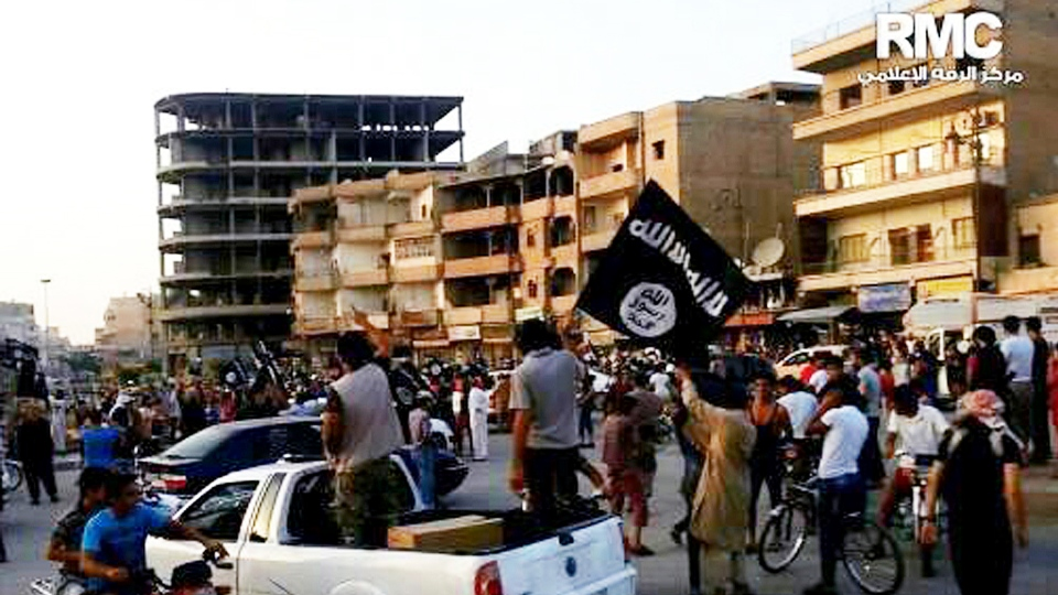 Fighters from the extremist Islamic State group parade in Raqqa, Syria in this undated file photo posted on Monday, June 30, 2014 by the Raqqa Media Center of the Islamic State group. (AP / Raqqa Media Center of the Islamic State group)