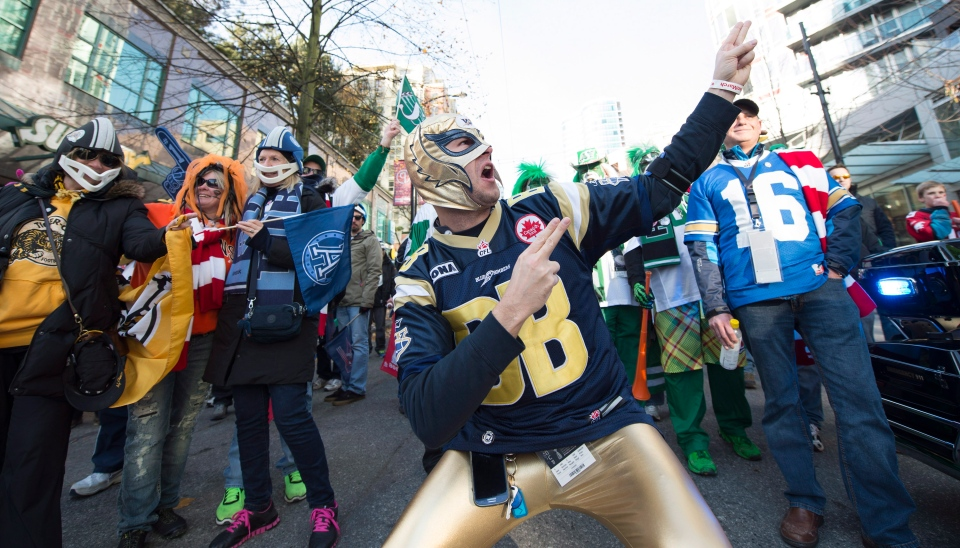 Football fans are seen prior to the 102nd Grey Cup between the Calgary Stampeders and the Hamilton Tiger-Cats in Vancouver, B.C. Sunday, Nov. 30, 2014. (Nathan Denette / THE CANADIAN PRESS)