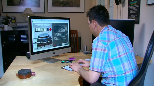 Richard Fitoussi works on his website for 'Landmine ER' a documentary about the horrors of landmines in Cambodia.