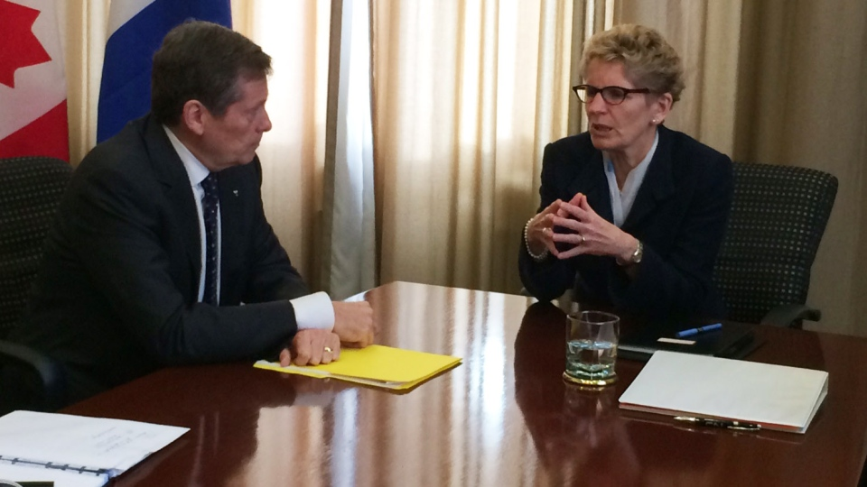 Toronto Mayor John Tory sits with Ontario Premier Kathleen Wynne in Toronto on Monday, Dec. 1, 2014. (Keith Hanley / CTV Toronto)