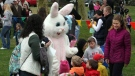 An Easter Bunny greets children during an annual Easter egg hunt in Linwood, N.J., on March 31, 2012. (AP /The Press of Atlantic City, Vernon Ogrodnek)