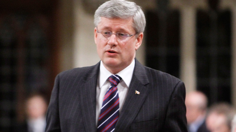 Prime Minister Stephen Harper stands in the House of Commons during question period in Ottawa, Thursday, April 5, 2012 (Fred Chartrand / THE CANADIAN PRESS)