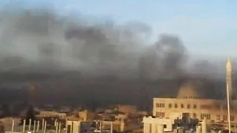 This image made from amateur video purports to show black smoke from shelling billowing into the sky air in Aleppo, Syria, on Wednesday, April 4, 2012. (AP / Shaam News Network via APTN)