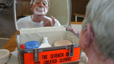 "In this March 29, 2012, photo, Floyd ""Creeky"" Creekmore puts on his makeup before a performance in Billings, Mont."