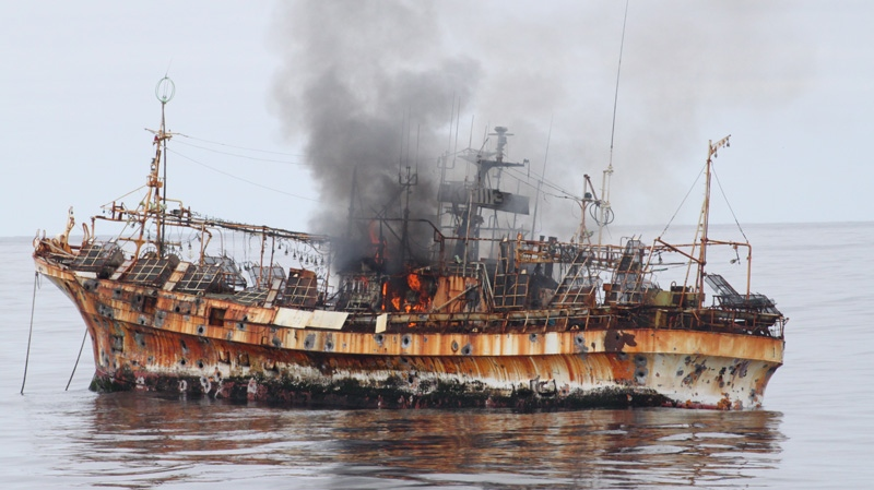 A plume of smoke rises from the derelict Japanese ship Ryou-Un Maru after it was hit by canon fire by a U.S. Coast Guard cutter on Thursday, April 5, 2012, in the Gulf of Alaska. (U.S. Coast Guard)