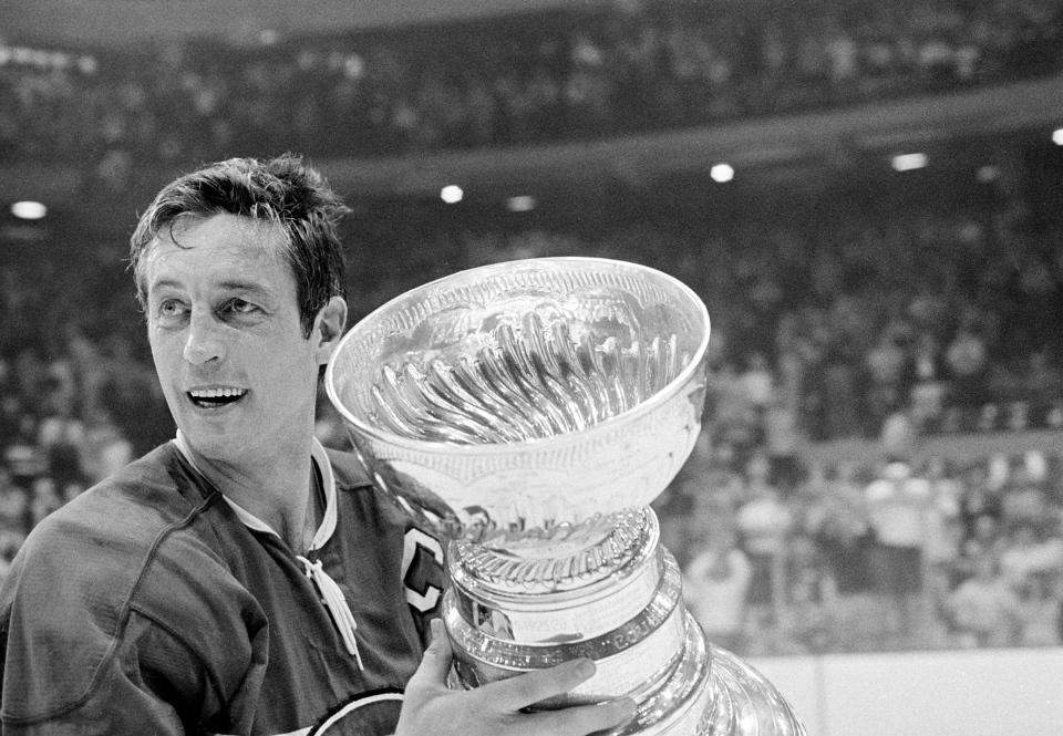 Montreal Canadiens team captain Jean Beliveau holds the Stanley Cup trophy after his team's 3-2 victory over the Chicago Black Hawks in Tuesday May 18, 1971. (AP)