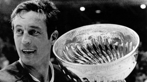 In this May 19, 1971, file photo, Montreal Canadiens team captain Jean Beliveau holds the Stanley Cup in Chicago following the Canadiens 3-2 victory over the Chicago Blackhawks. Beliveau died Tuesday, Dec. 2, 2014. He was 83. The team confirmed the death of the Hall of Fame center and one of the most beloved players in Canadiens history. (AP Photo)