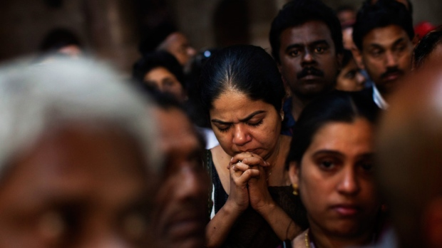 A Christian worshipper prays inside the Church of the Holy Sepulchre, traditionally believed to be the burial site of Jesus Christ, in Jerusalem's Old City