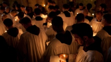 Catholic clergy attend a procession during Good Friday inside the Church of the Holy Sepulchre, traditionally believed to be the burial site of Jesus Christ