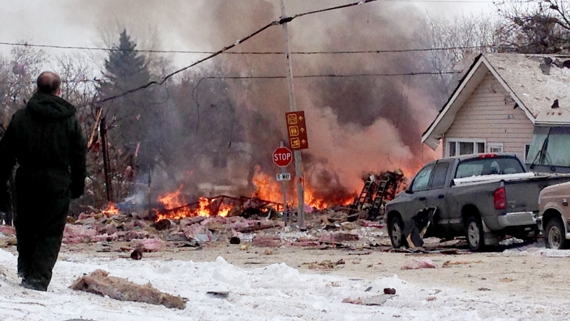 The remains of a house in Regina burn after an explosion Wednesday, Dec. 3, 2014. (My News / Keith Hubelit)