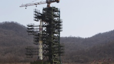 North Korea's Unha-3 rocket, slated for liftoff between April 12-16, stands at Sohae Satellite Station in Tongchang-ri, North Korea on Sunday April 8, 2012. (AP Photo/David Guttenfelder)