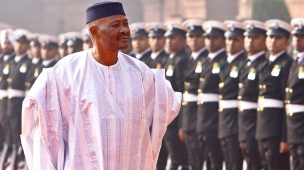 Malian President Amadou Toumani Toure inspects an honor guard during a ceremonial reception at the Presidential Palace in New Delhi, India, Wednesday, Jan. 11, 2012. (AP / Pankaj Nangia)