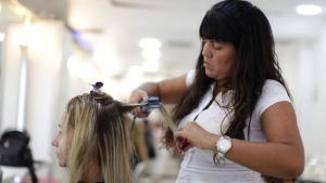 Adriana Guedes, left, has her hair straightened by hairdresser Tania Machado at a salon in Ipanema, Rio de Janeiro, Brazil, Feb. 3, 2011. (AP / Felipe Dana)