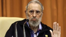 Cuba's Fidel Castro speaks during a meeting with members of the Japan-based international non-governmental organization, Peace Boat in Havana, Cuba, Thursday, March 1, 2012. (AP / Roberto Chile, Cubadebate)