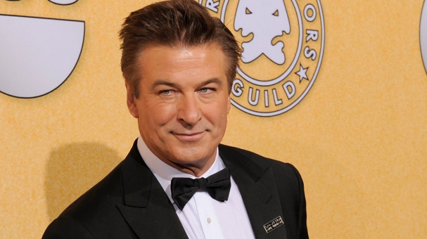 "Alec Baldwin poses backstage with the award for outstanding performance by a male actor in a comedy series for ""30 Rock"" at the 18th Annual Screen Actors Guild Awards on Sunday Jan. 29, 2012 in Los Angeles. (AP Photo/Chris Pizzello)"