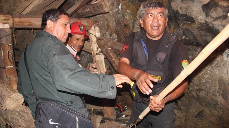 People work in a collapsed mine to rescue trapped miners in Ica, Peru, Saturday, April 7, 2012. (AP)