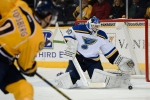 St. Louis Blues goalie Martin Brodeur (30) blocks Nashville Predators center Filip Forsberg's (9), of Sweden, shot in the first period of an NHL hockey game Thursday, Dec. 4, 2014, in Nashville, Tenn. (AP Photo/Mark Zaleski)