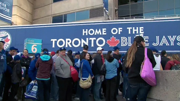 A crowd of Toronto Blue Jays fans gather outside of the Rogers Centre prior to the team's home opener in Toronto on Monday, April 9, 2012.