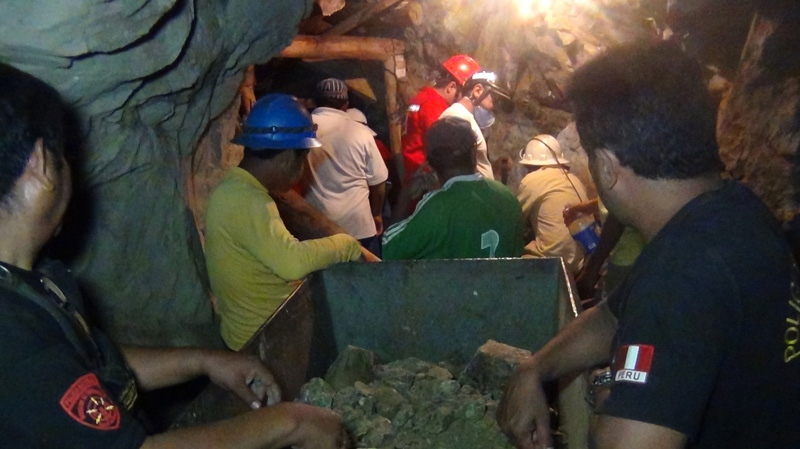 People work in a collapsed mine to rescue trapped miners in Ica, Peru, Saturday, April 7, 2012. (AP Photo)