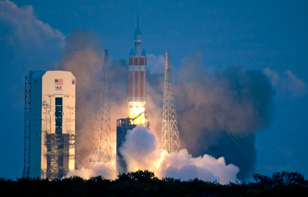 The NASA Orion space capsule atop a Delta IV rocket, in its first unmanned orbital test flight, lifts off from the Space Launch Complex 37B pad at the Cape Canaveral Air Force Station, Friday, Dec. 5, 2014, in Cape Canaveral, Fla. (AP / John Raoux)