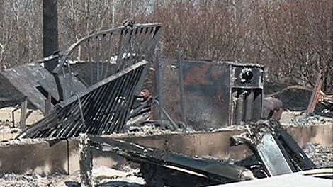 Charred furniture and belongings are scattered on Sweetgrass First Nation