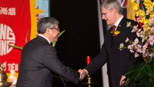Harper shakes hands with Senator Thanh Hai Ngo