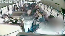 Police are praising teenage students who safely stopped a school bus after the driver was apparently stricken with a heart attack.