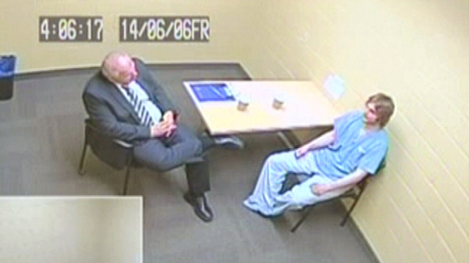 In this photo taken from video ordered released by a New Brunswick judge, Justin Bourque is interrogated by RCMP officials after a June 4, 2014 shooting rampage in Moncton.