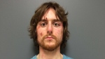 Justin Bourque is shown in this RCMP booking photo taken June 6, 2014. (RCMP)
