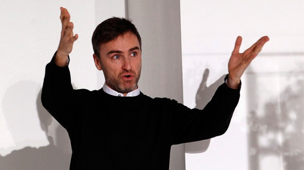 Belgian designer Raf Simons acknowledges the applause of the audience at the end of the Jil Sander Spring/Summer 2012 women's collection in Milan, in this Saturday, Sept. 25, 2011. (AP / Giuseppe Aresu)