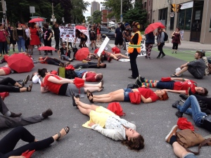 Demonstrators protest Canada's proposed prostitution legislation on a Toronto street in this June 14, 2014 file photo. (William Campbell / THE CANADIAN PRESS)