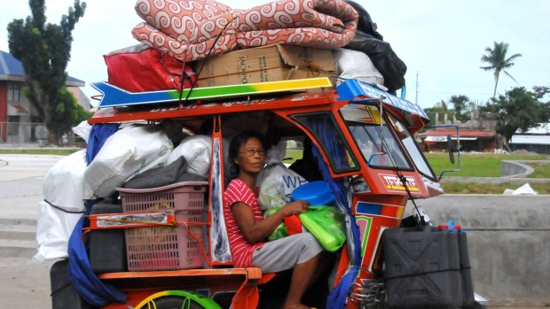 Typhoon survivors, some of whom are still living in tents, evacuate to safer grounds with their belongings at Tanauan township, Leyte province in central Philippines Thursday, Dec. 4, 2014. (AP / Paul Cinco)
