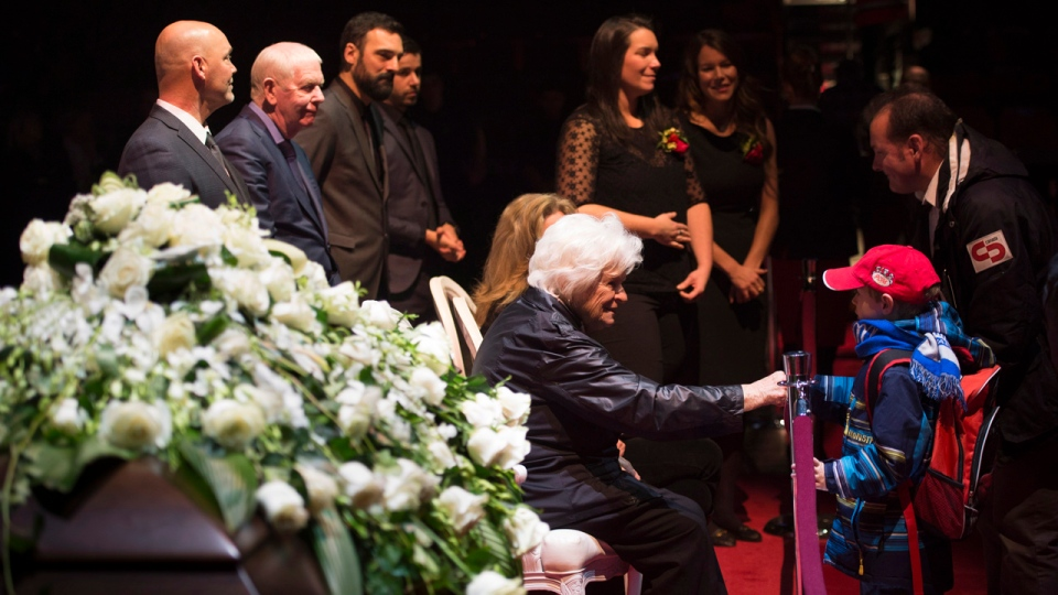 Mourners offer their condolences to Elise Beliveau wife Montreal Canadiens legend Jean Beliveau and family during the public viewing for the Montreal Canadiens legend Sunday, December 7, 2014 in Montreal. Beliveau died at the age of 83. THE CANADIAN PRESS/Paul Chiasson
