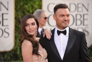 Megan Fox, left, and Brian Austin Green arrive at the 70th Annual Golden Globe Awards at the Beverly Hilton Hotel in Beverly Hills, Calif., on Sunday Jan. 13, 2013. (Invision / John Shearer)