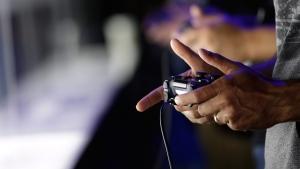 Playing PlayStation 4 in Los Angeles, Calif., on June 13, 2013. (AP / Jae C. Hong)