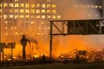 Los Angeles County firefighters battle a fire at an apartment building under construction next to the Harbor CA-110 Freeway in Los Angeles, early Monday, Dec. 8, 2014. (AP / Damian Dovarganes)