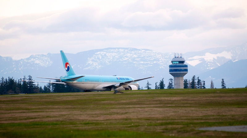 A Korean Air Boeing 777 is shown on the runway in Comox, B.C. on Tuesday April 10, 2012. (Richard Warrington / THE CANADIAN PRESS)