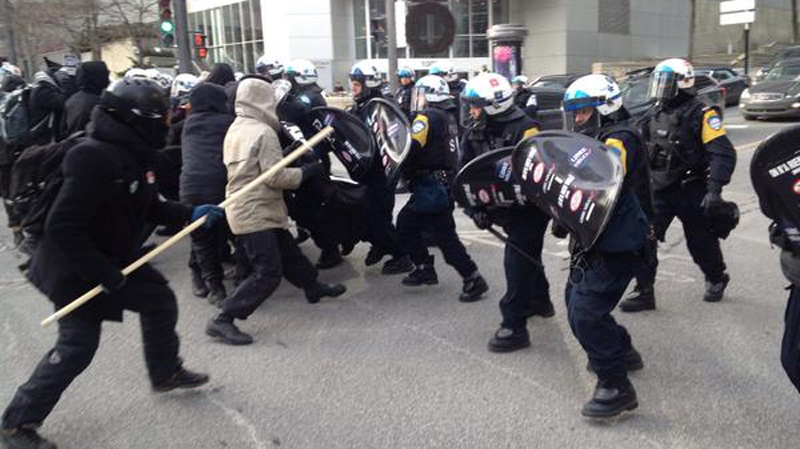 Montreal police are seen clashing with demonstrations in downtown Montreal Monday morning. (Maya Johnson CTV Montreal)