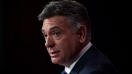 Ontario Finance Minister Charles Sousa speaks during a press conference at Queen's Park in Toronto on Monday, Sept. 22, 2014. (The Canadian Press/Darren Calabrese)